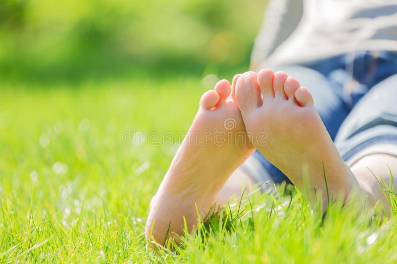 Bare feet on green grass. Copy space royalty free stock photos