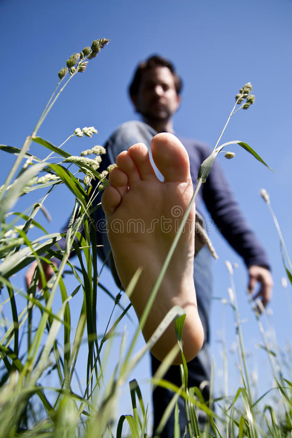 Bare feet on green grass royalty free stock images