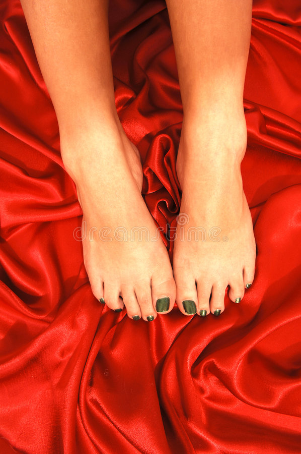 Bare feet on red.
