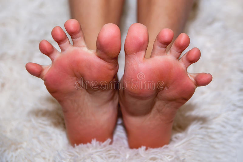 Bare feet on wool stock image