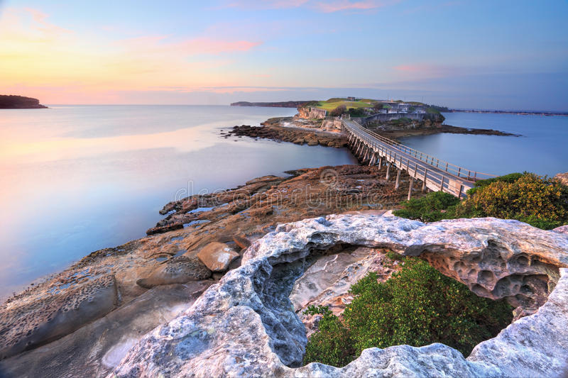Bare Island, Australia. Bare Island Australia, view from La Perouse, Sydney bathed in pretty pastel pink and yellow light at sunrise on a calm summers morning royalty free stock photos