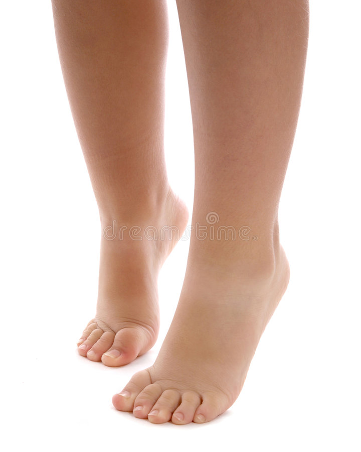 Bare legs and feet of child stock images