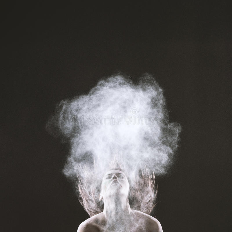Bare Woman Throwing Head Back with Smoke Effect. Bare Young Woman Throwing Head Back, with Hair Flying Up, Styled with Smoke Effect. Captured on Gray Background stock photo