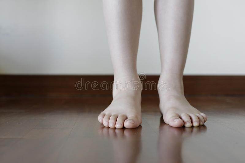 Barefeet in the wood apartment stock image