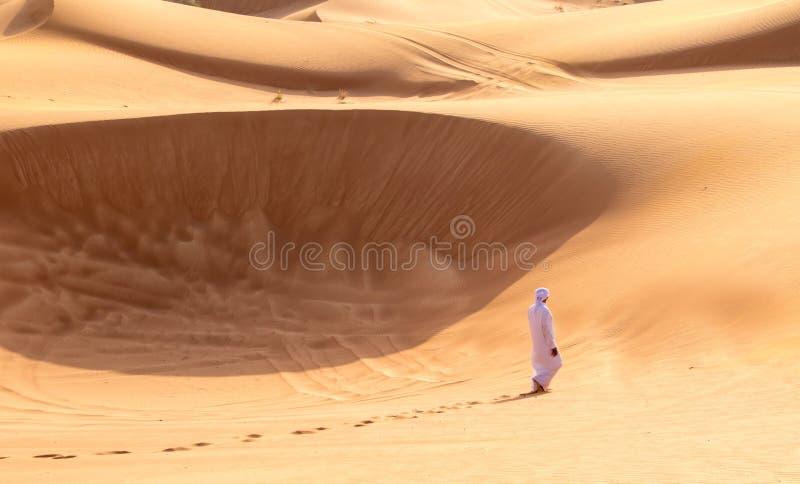 Barefoot Bedouin Walking in Desert of Sharjah stock image