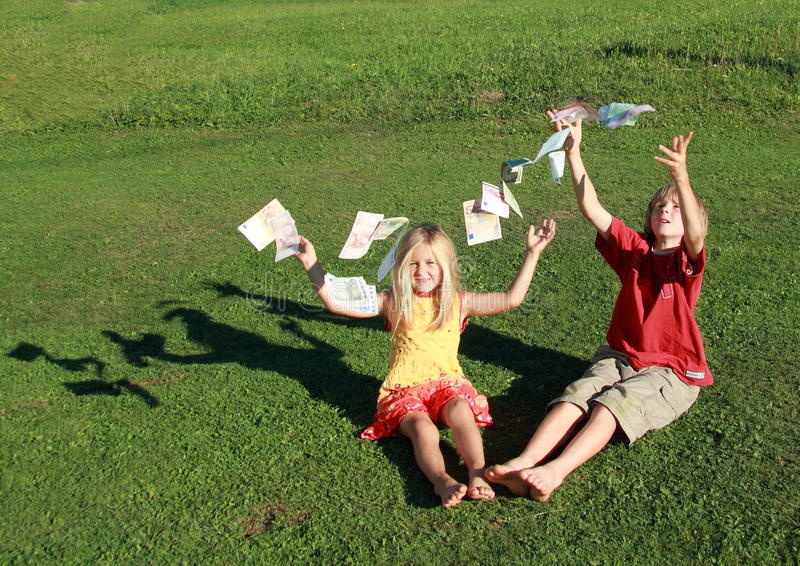 Barefoot boy and girl throwing money royalty free stock photo