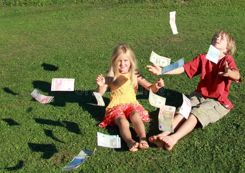 Barefoot boy and girl throwing money royalty free stock images