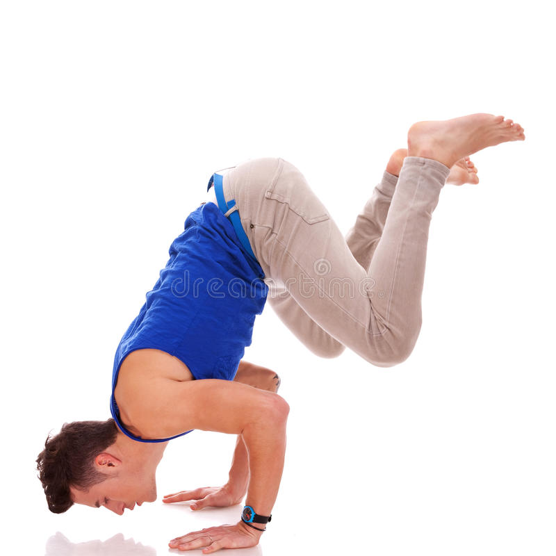 Barefoot casual man doing a handstand stock photography