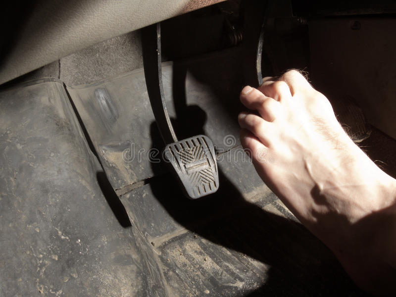 Barefoot foot on the brake pedal royalty free stock image