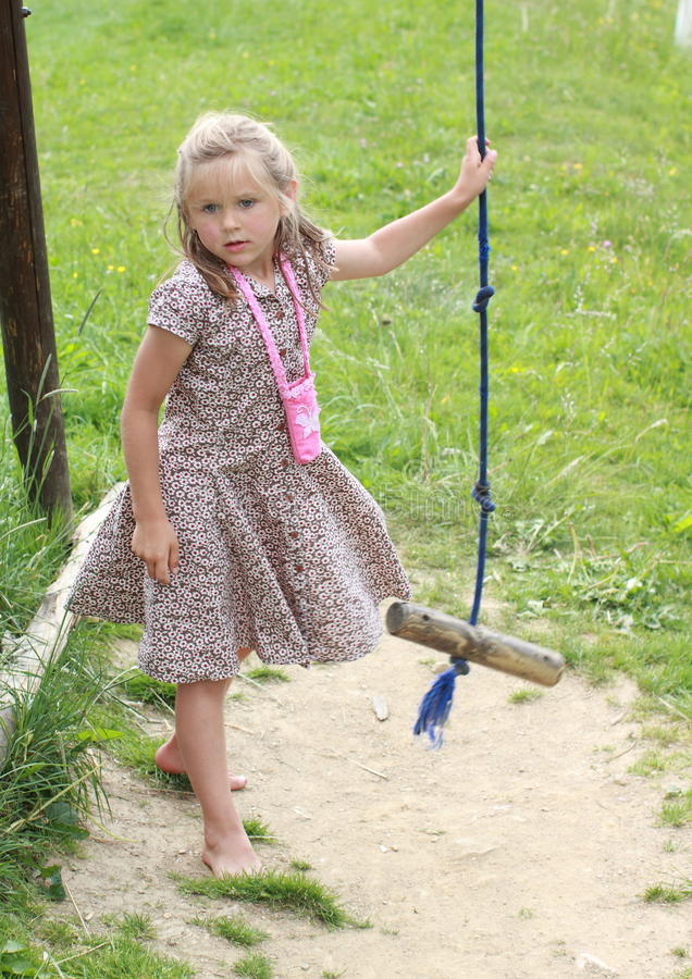 Barefoot girl holding a swing royalty free stock photos