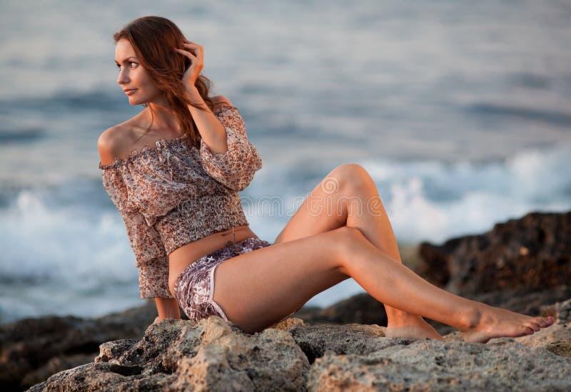 Download Barefoot Girl Sitting On Rock Stock Photo - Image: 22985934