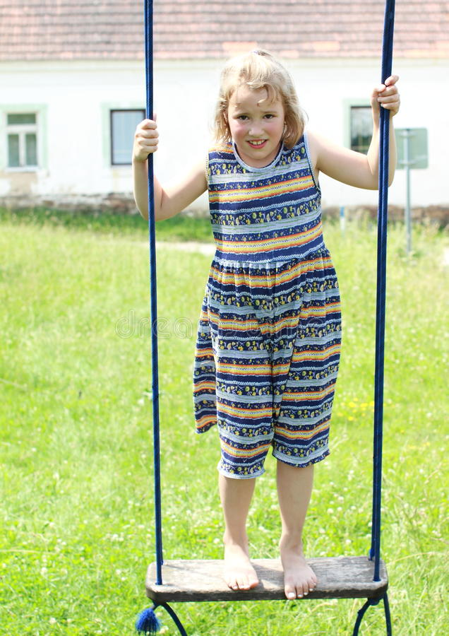 Download Barefoot girl on a swing stock photo. Image of standing - 25516016