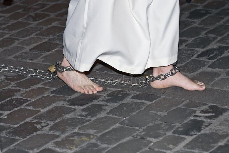 Barefoot penitent. stock image