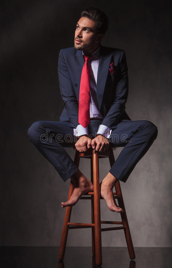 Barefoot Pensive business man looking up royalty free stock image