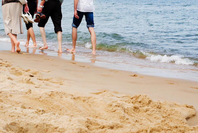 Barefoot people walking on sand beach royalty free stock photos