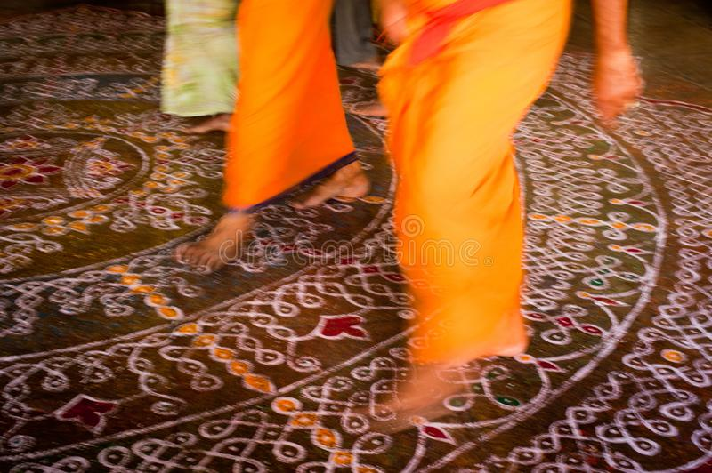 Barefoot pilgrims walking on the floor with painted mandala  in Hindu temple. India royalty free stock photo