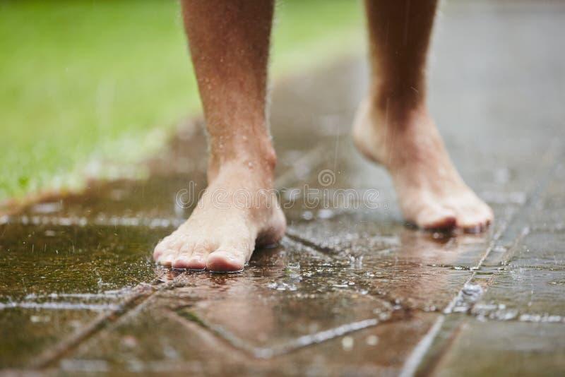 Barefoot in rain royalty free stock photos