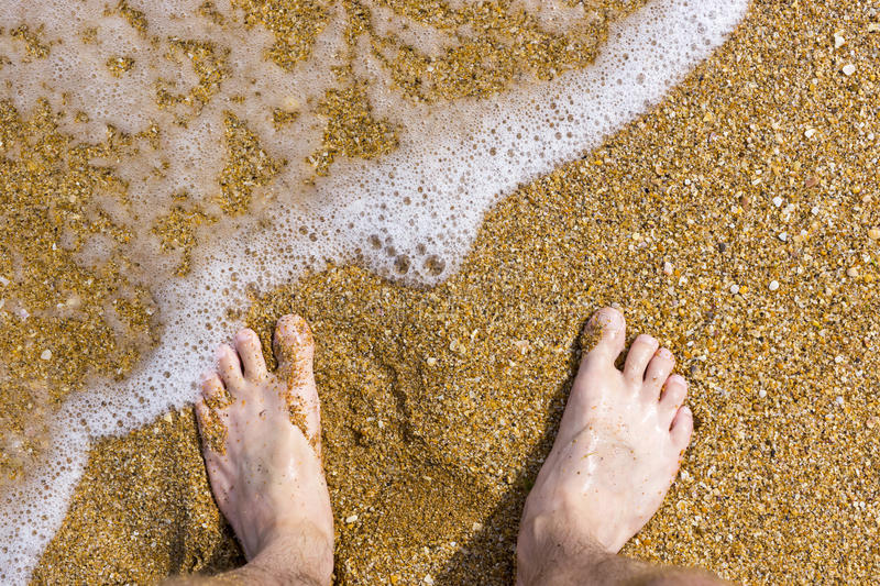 Barefoot on sea surf sand. Beach stock images