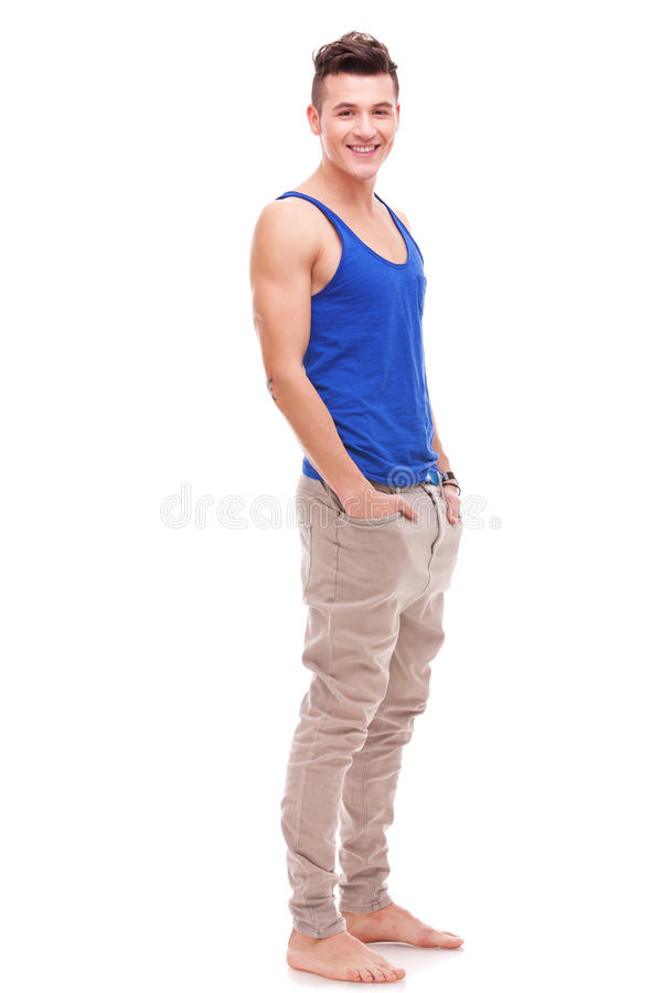 Download Barefoot young man stock photo. Image of denim, barefoot - 23362312