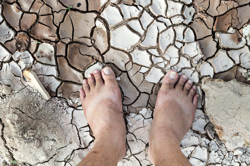 Barefoot standing on dry and cracked ground stock image image of download barefoot standing on dry and cracked ground stock image image of human conservation malvernweather Images