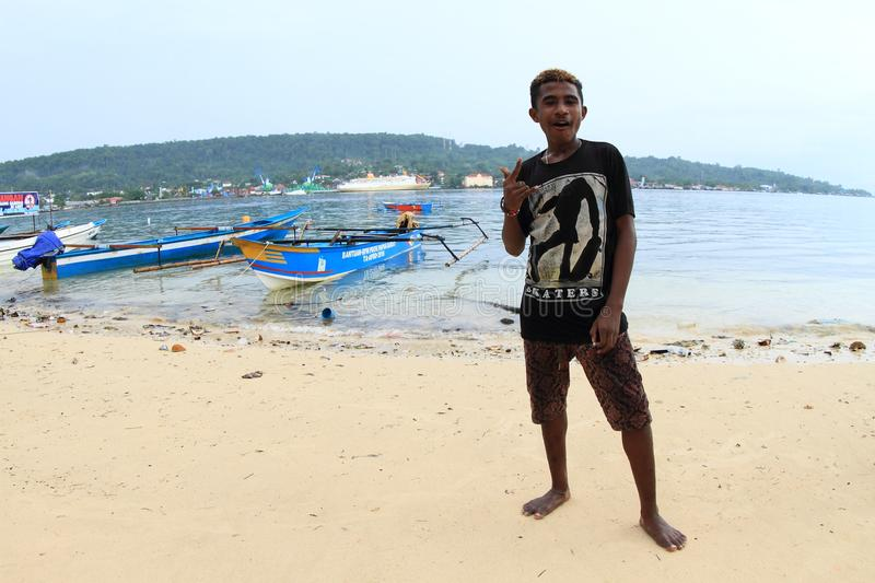 Teenage boy on beach in Manokwari royalty free stock photo