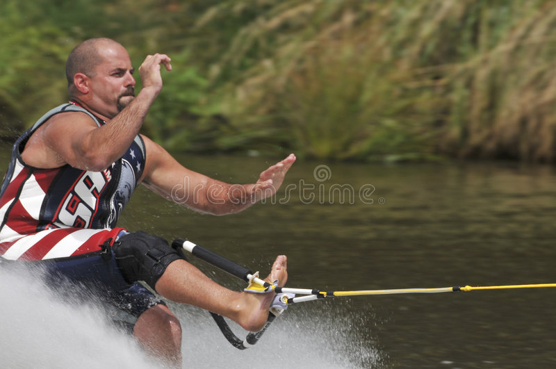 Barefoot Water Skier 04. MCU Forwards Toehold - A barefoot water skier skiing at the World Championships, USA Team wetsuit royalty free stock photos
