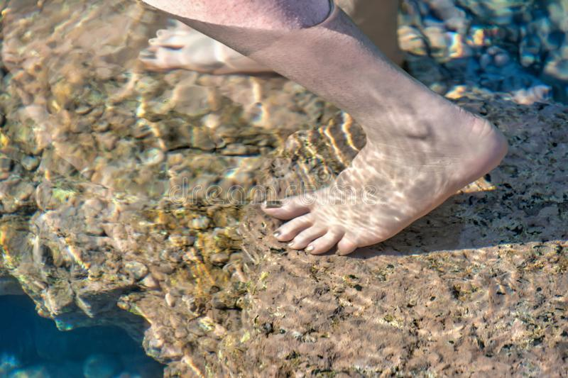 Barefoot woman feeling the ocean royalty free stock images