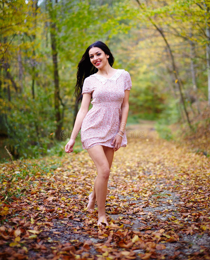 Nature Dress: Barefoot Woman In The Forest Stock Photo