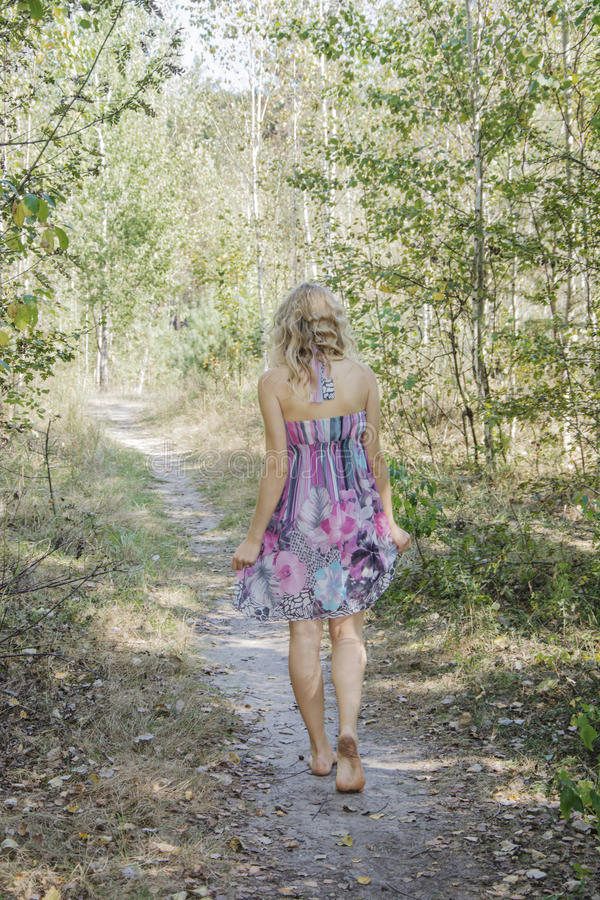 Barefoot Woman Walking Through The Forest Stock Image