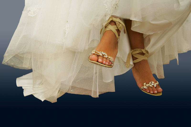 Barefooted legs of the bride