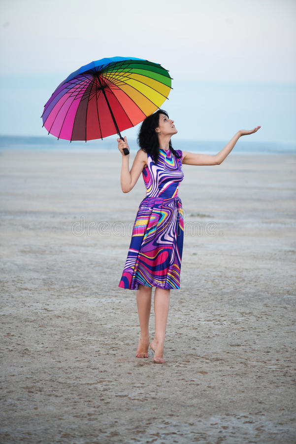 Free Barefooted Woman With Colorful Umbrella Stock Photo - 34125370