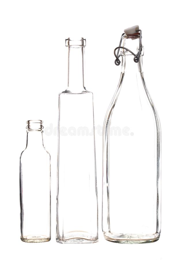 Barely there clear glass bottles, isolated on white background. Outlines stock photos