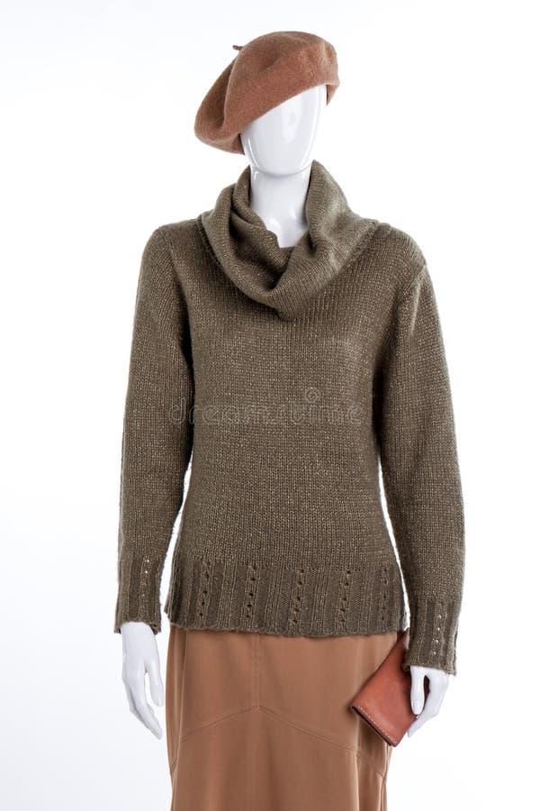 Baret, sweater, rok en beurs royalty-vrije stock foto's