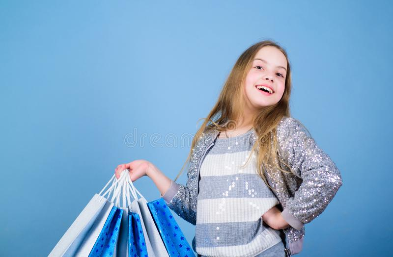 Bargain sale. Kid fashion. shop assistant with package. Sales and discounts. Small girl with shopping bags. Happy child. Little girl with gifts. special offer stock photo