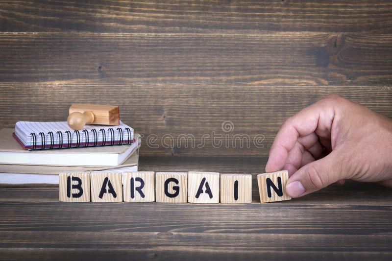 Bargain. wooden letters on the office desk stock photography