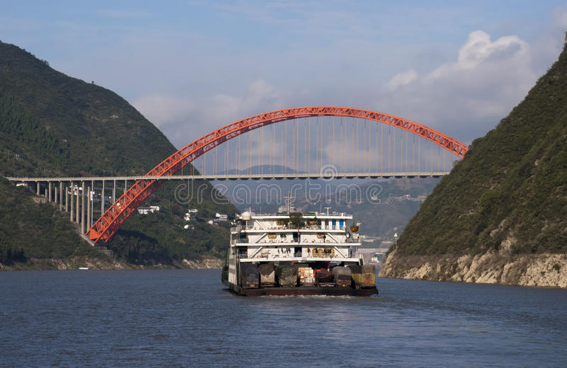 Barge and Bridge Yangtze River China Cruise. Scene of barge and bridge on Yangtze River cruise in China. The Chinese use the river to haul freight and royalty free stock images