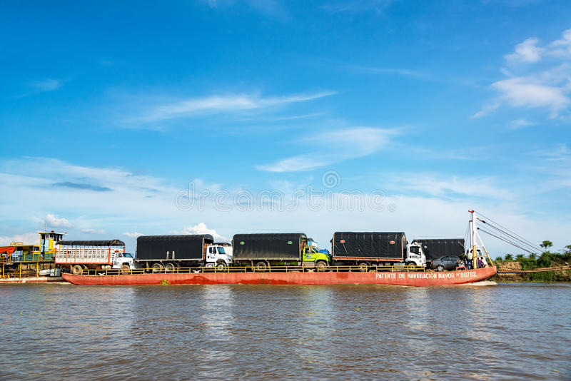Barge Carrying Trucks near Magangue stock image