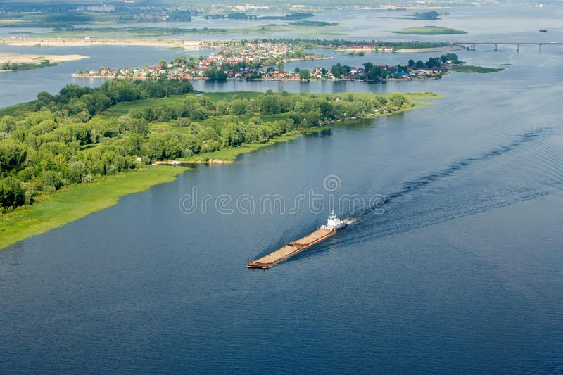 Barge on the dark blue expanses of the Volga from the height of the helicopter royalty free stock image