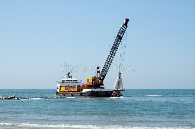 Download Barge Dredging A Harbor Royalty Free Stock Photo - Image: 14588385