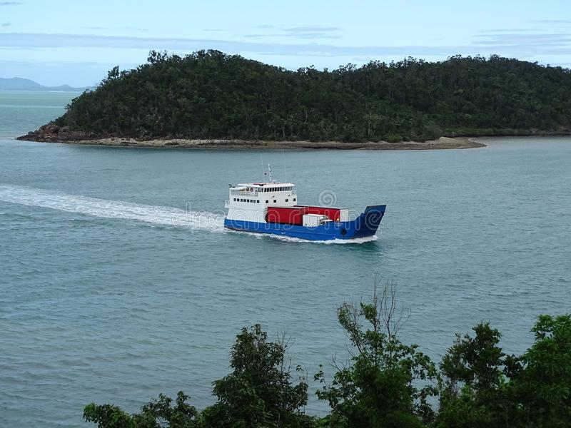 A barge entering Shute Harbour on completion of its journey from Hamilton Is royalty free stock photos