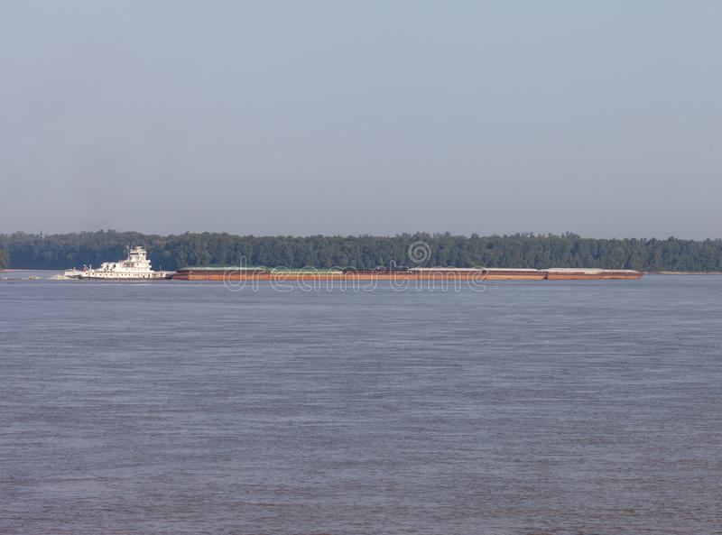 Barge on the Mississippi River royalty free stock image