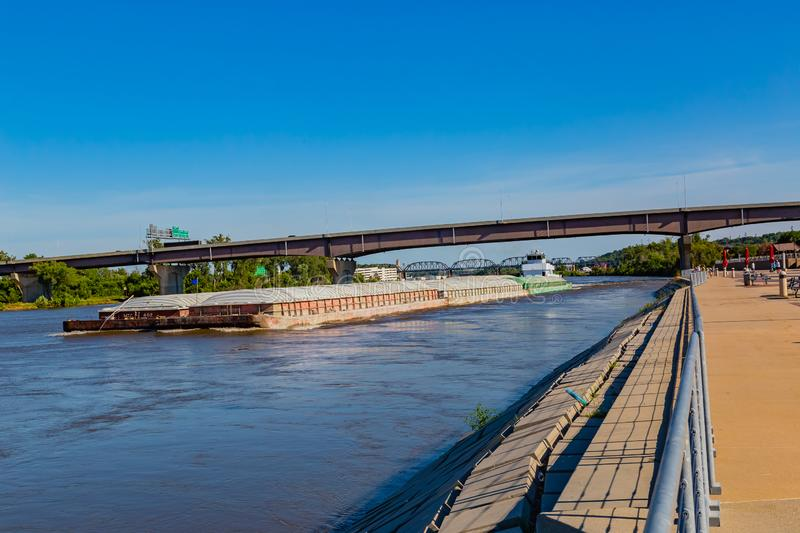 A barge moving northwards on River Missouri at Omaha royalty free stock image