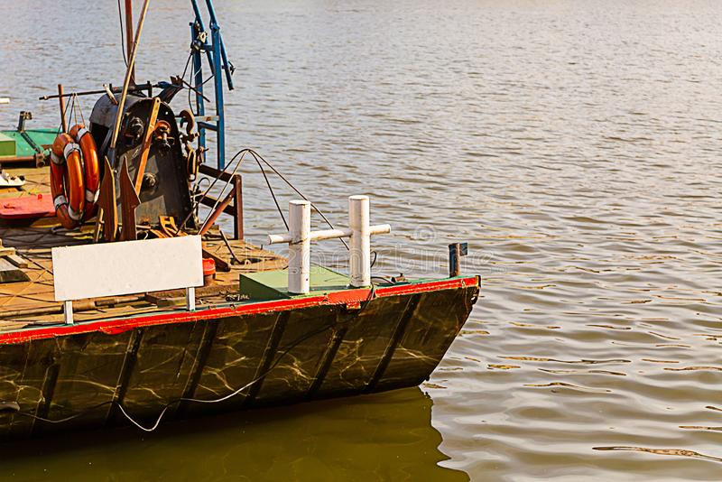 Barge old and rusty boat for river cargo delivery traditional transport with mooring bollards white on deck royalty free stock photography