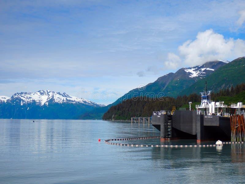 A barge in port at valdez harbor stock photography