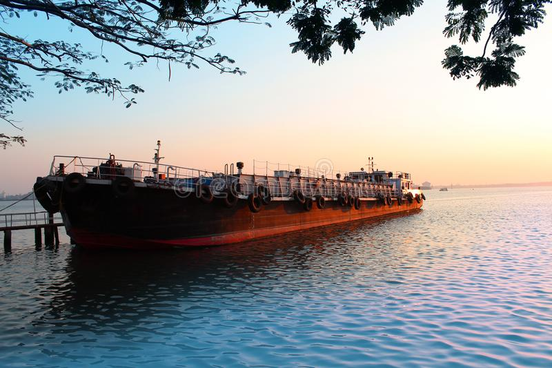 Barge on the river in evening sunset. stock images