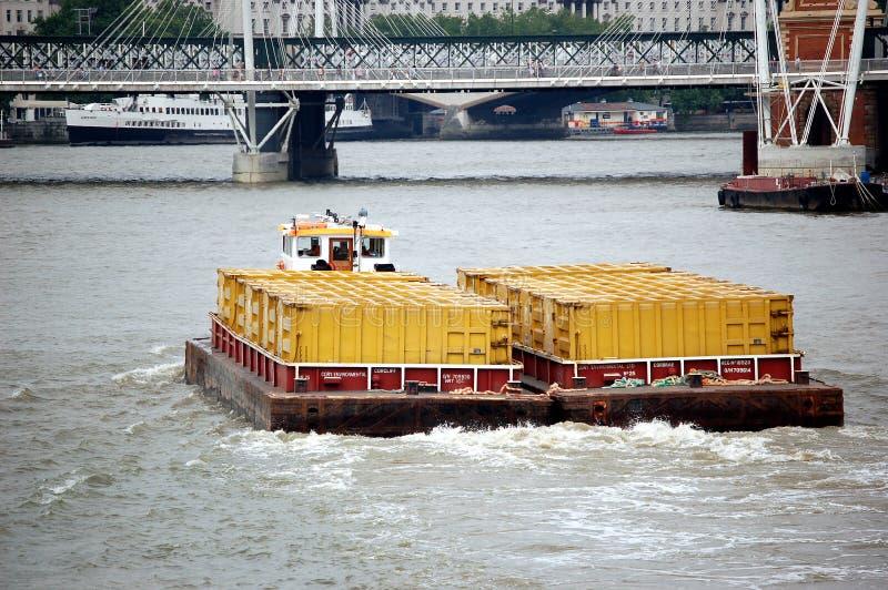 Barge on Thames River. Tugboat barge on Thames River, London, England stock images