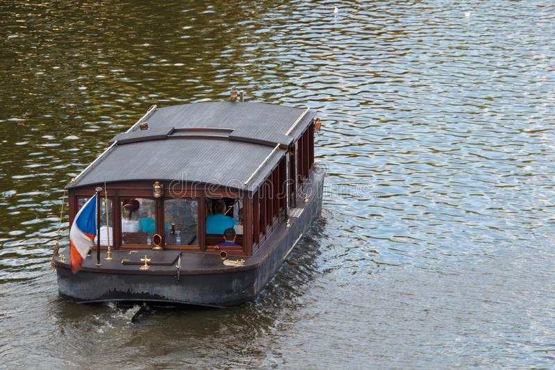 Barge on Vltava. Barge with tourists on Vltava river in Prague stock photos