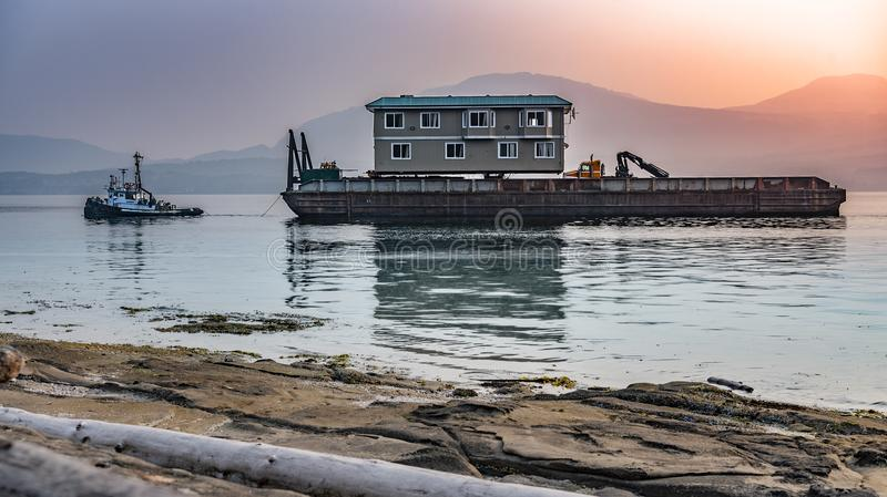 Barge water transporting moving building stock photos