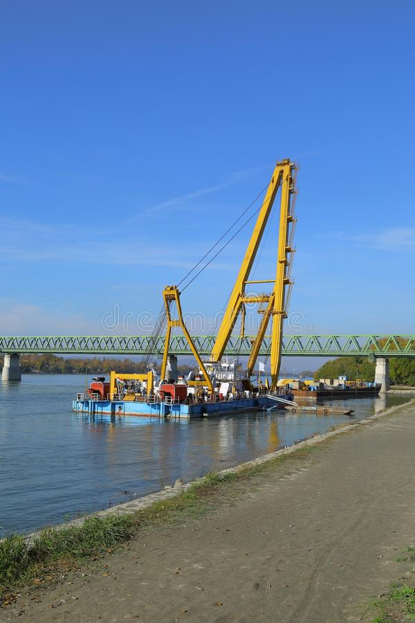 Barges with construction equipment. Barge with huge construction crane royalty free stock images