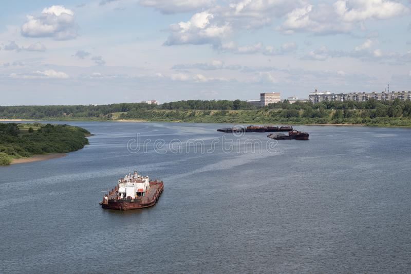 barges float down the river with cargo stock photo